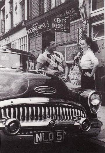US1950s Couple On A Buick Skylark