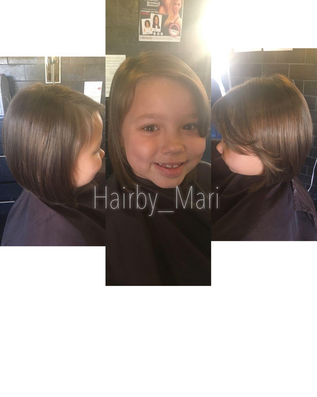 Aline bob haircut with side swept bangs