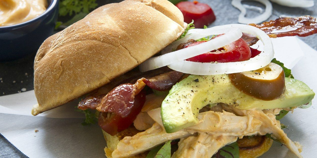 Chipotle Chicken Sandwich with Bacon and Avocado - This simple sandwich packs a ton of flavor without taking a lot of effort. The spicy chipotle mayonnaise adds a soft smoky heat to the chicken, and helps the buns get a deep crispness while they toast.