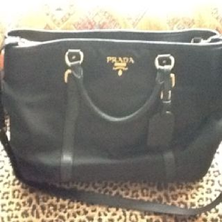 My gifted Prada came back to me brand new....LOVE!