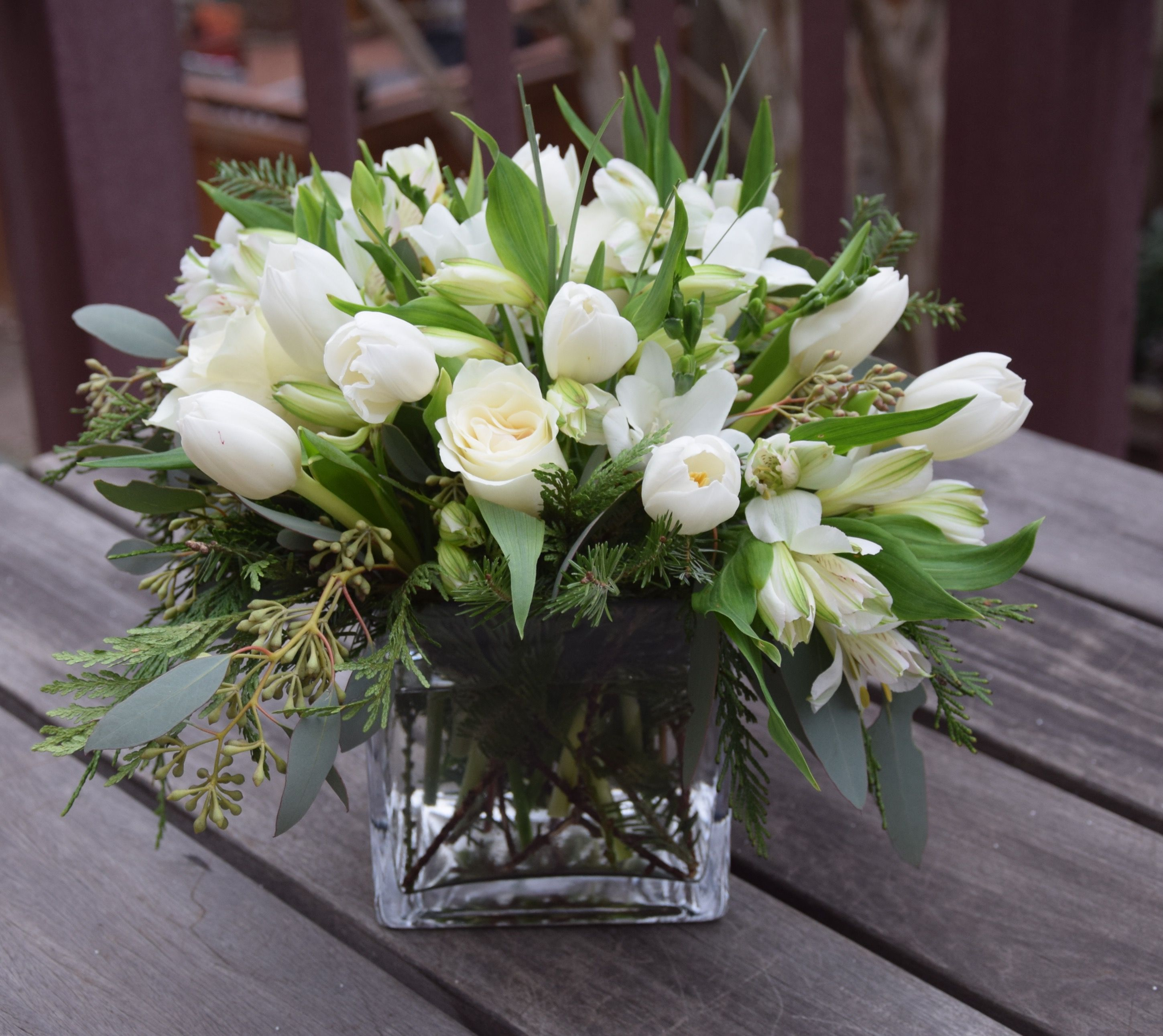 Flower Arrangement In A Glass Vase With White Flowers And Greens Matrimonio
