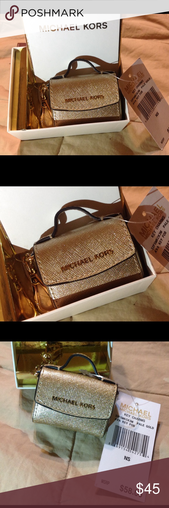 Michael KORS Gold bag keychain NWT Michael KORS key charm.  This is a pale gold hand bag  with a snap closure that opens...very cute!  New in original gift box with tag   NO TRADES Michael Kors Accessories Key & Card Holders