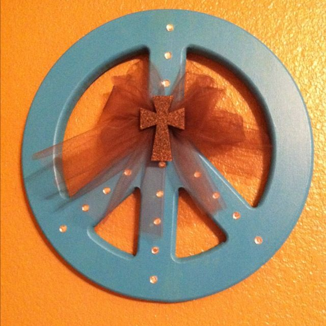 Wooden peace sign painted with tulle and a stone spray painted cross and rhinestones.  For Lauren's room.
