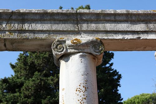 """An Ionic column capital from the Christian Basilica at Ostia Antica, leading into apsidal hall """"D."""". Material: Proconnesian marble Location: Reg. III, 1. 4. Like other examples of late (here early fifth century?) capitals from Ostia, the treatment of the details here is summary. Pensabene, Scavi di Ostia, vol. VII: I Capitelli (1972); cat. no. 195, pg. 52."""