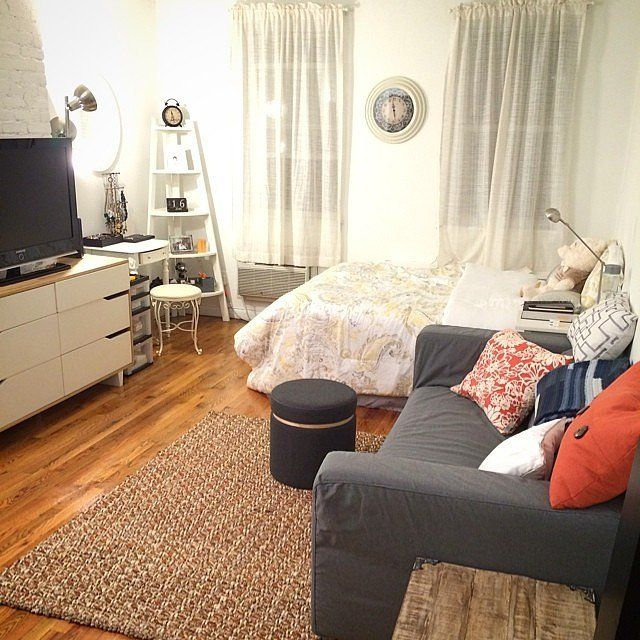 By Aligning The Couch With The Tv To Create A Living Space