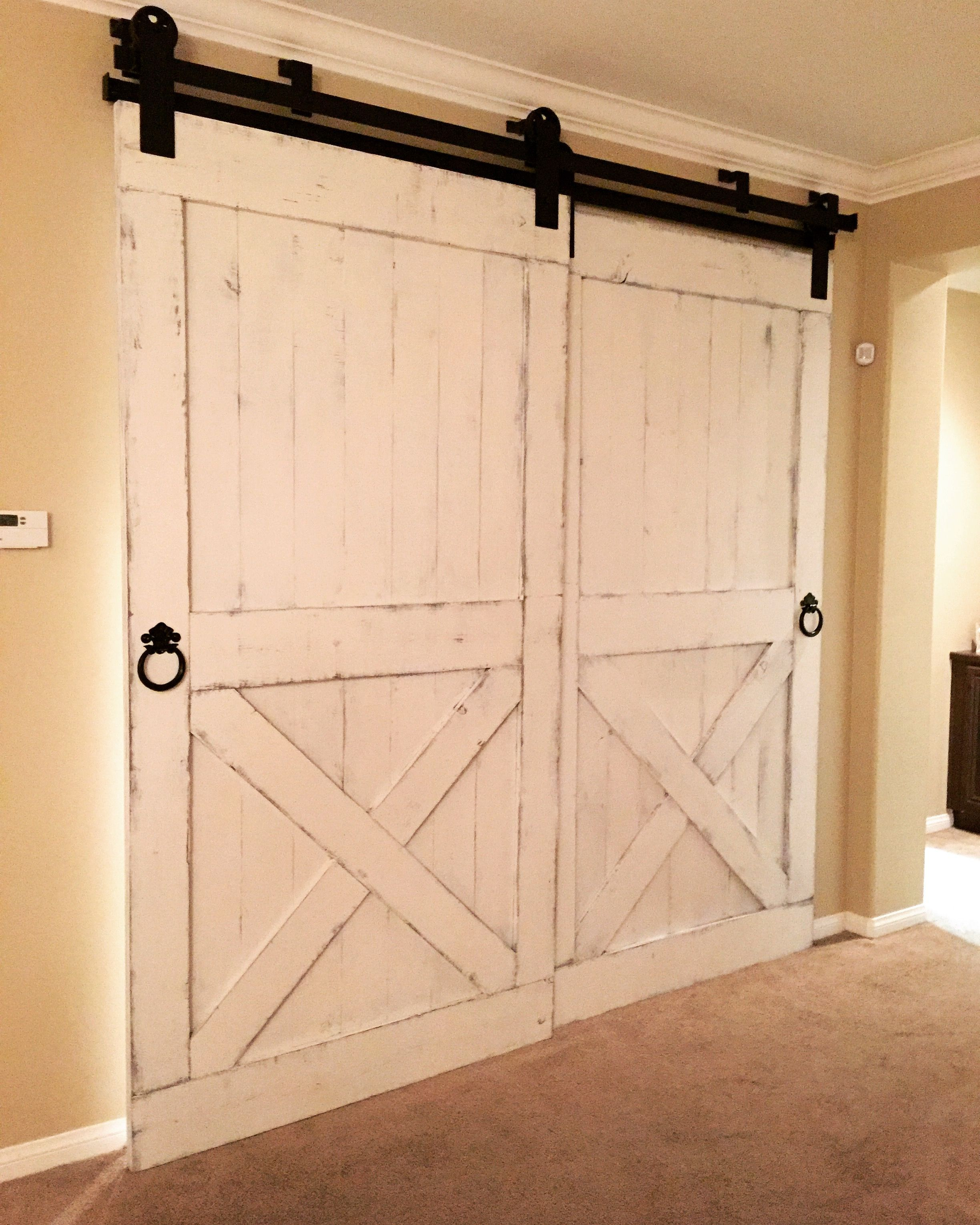Distressed White Barn Doors With Byp Hardware For A Bar