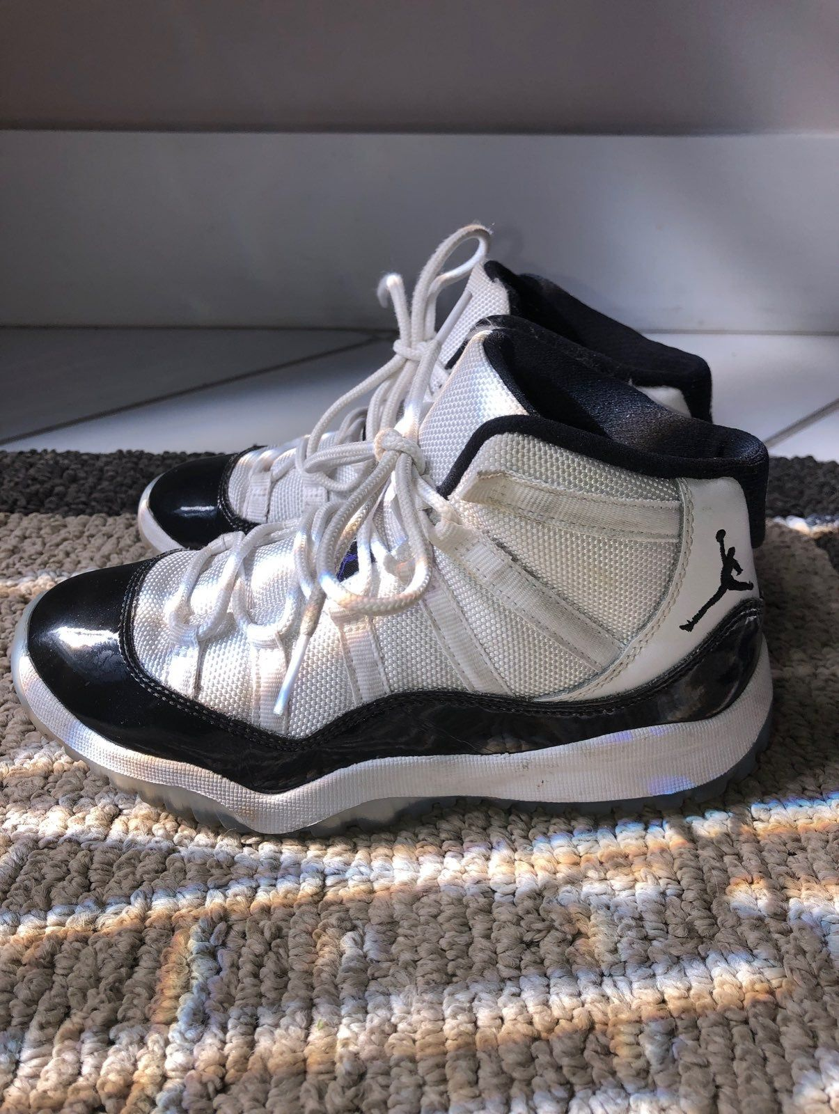 Black and white 11's. Gently used with stitching, soles and glue ...