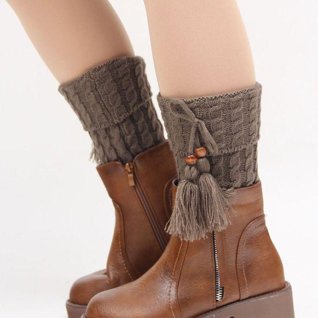 La pierna de punto para mujeres de la borla de arranque puños ...