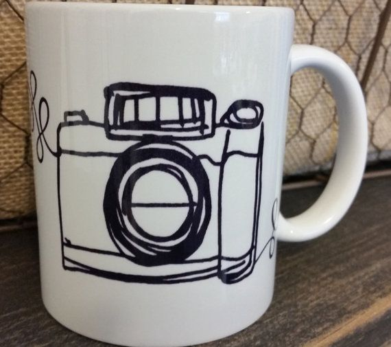 Life is like a camera Sublimation Coffee Mug. Both microwavable and dishwasher safe! These 11 oz white ceramic mugs have graphics and or text on both sides of the mug. The mugs require a special ink and heat transfer process, making them microwavable and dishwasher safe. They are not stickers, vinyl or sharpie markers.