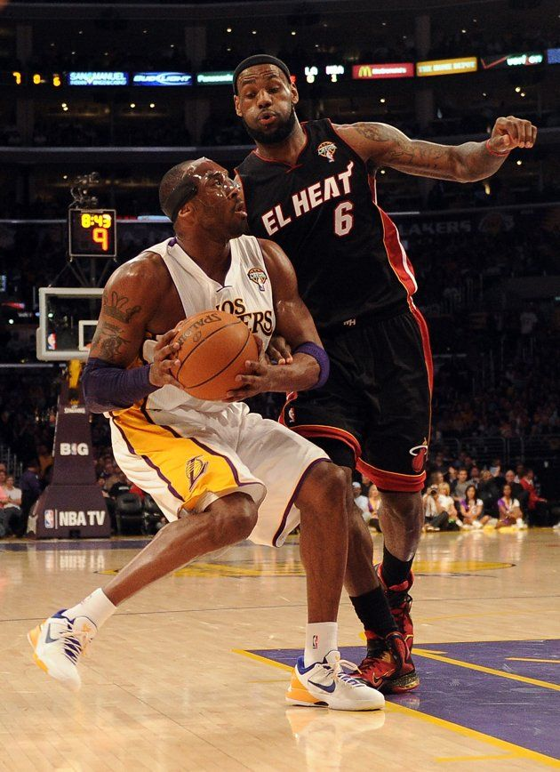 Kobe Bryant 24 Of The Los Angeles Lakers Attempts A Shot As He Is Guarded By Lebron James 6 Of The Miami Hea Los Angeles Lakers Miami Heat Kobe Bryant Family