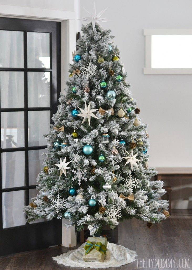 Our teal green silver and white vintage inspired flocked christmas our teal green silver and white vintage inspired flocked christmas tree the diy mommy solutioingenieria Images