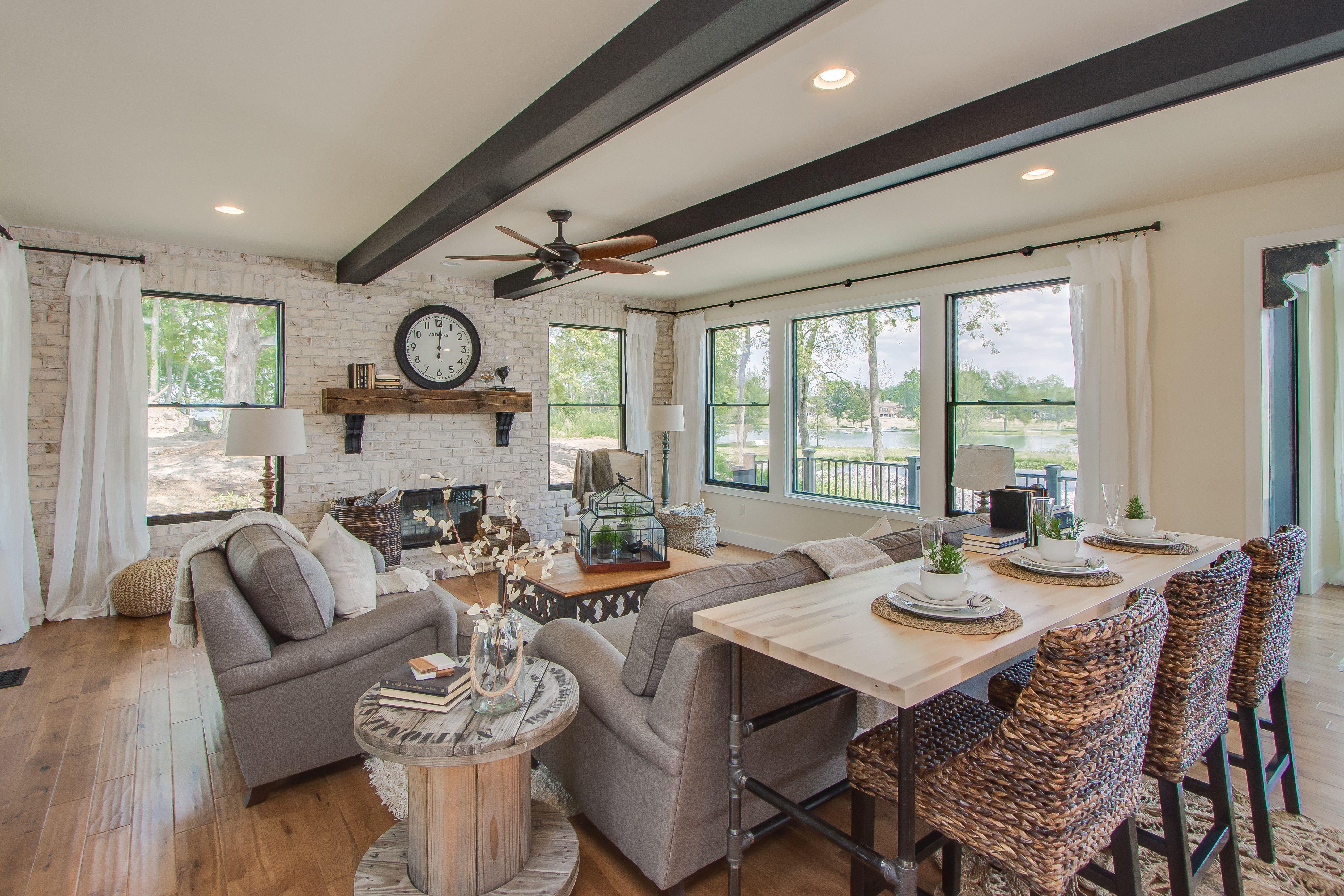 Living Room Hand Scraped Oak Hardwood Floors Painted Ceiling Beams Floating Fireplace
