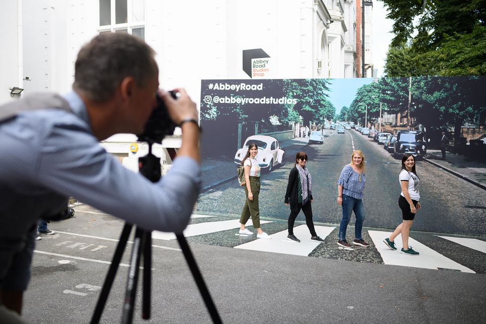 Photos On 50th anniversary of Beatles' Abbey Road cover