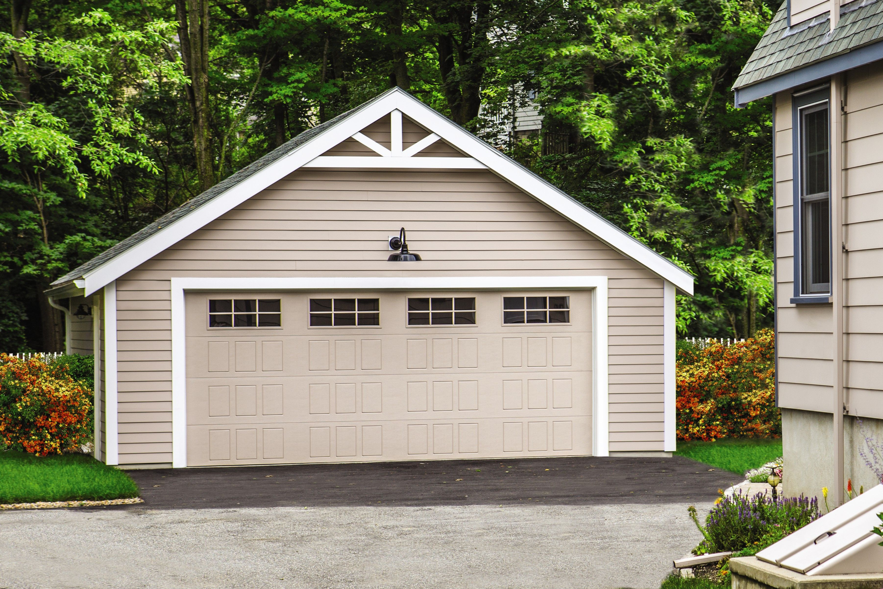 Unconnected Garage With A Designer Steel Garage Door In 2020 Steel Garage Doors Wayne Dalton Garage Doors Garage