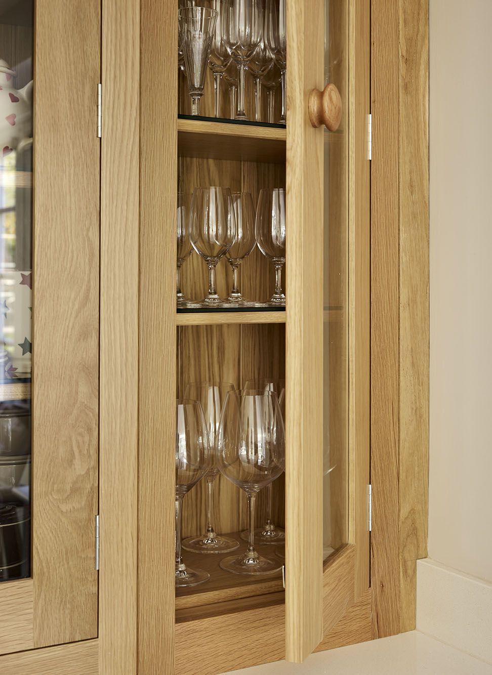 An oak Shaker kitchen, featuring glazed cabinets. # ...