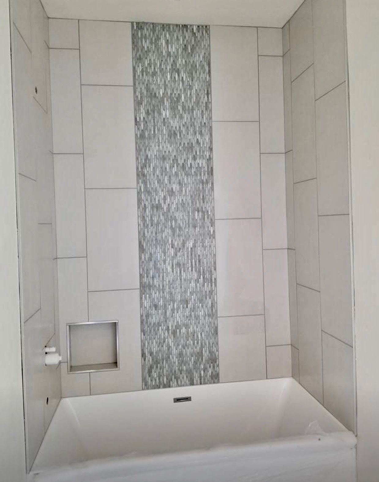 Bath tub tiles surround with mother of pearl accent tile through the ...