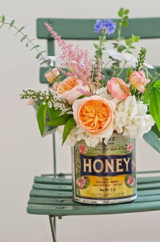 Vintage can used as a beautiful vase.