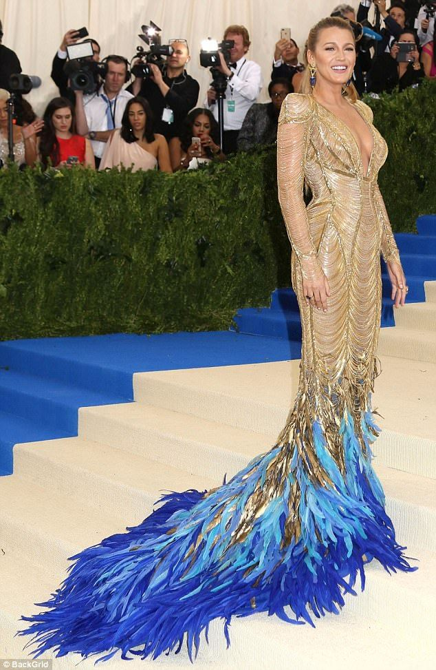 747024b240a Blake Lively is a goddess in gold and feather gown at The Met Gala ...