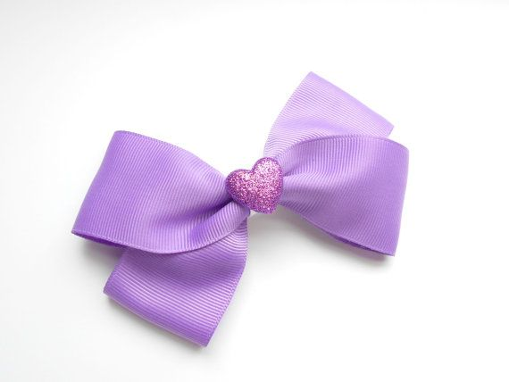 Girls purple hair bow with sparkling heart center.