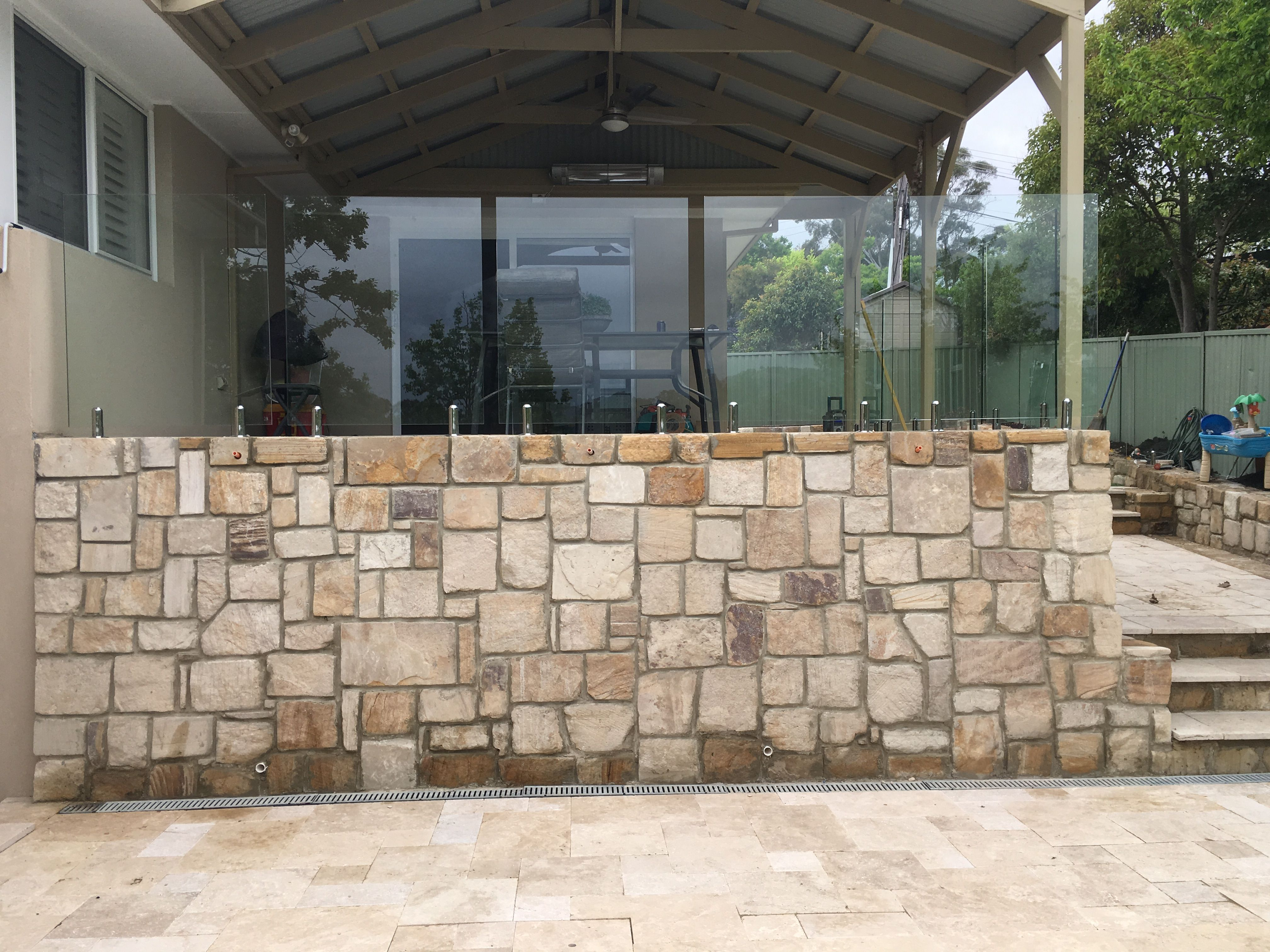 Sandstonewall Sandstone Feature Wall Around A Swimming Pool Landscaping Retaining Walls Glass Fence Retaining Wall