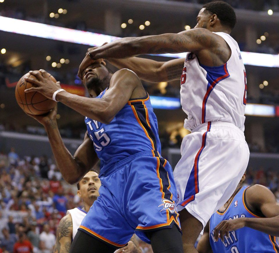 Oklahoma City's Kevin Durant (35) is fouled by Los Angeles' DeAndre Jordan (6) during Game 4 of the Western Conference semifinals in the NBA playoffs between the Oklahoma City Thunder and the Los Angeles Clippers at the Staples Center in Los Angeles, Sunday, May 11, 2014. Photo by Nate Billings, The Oklahoman