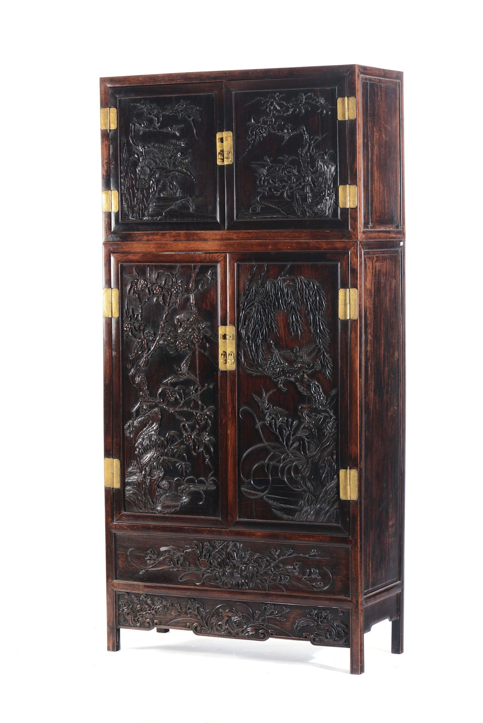 A large and important zitan and huanghuali compound cabinet with ...