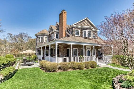 How charming is this house? Take a tour on my blog today, it is incredibly beautiful. #home #house #porch #porchideas #wraparoundporch #coastal #coastalhome #architeture #landscape #beachpretty #livebeachpretty