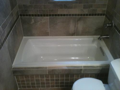 KOHLER Archer 5 ft. Reversible Drain Acrylic Soaking Tub in White ...