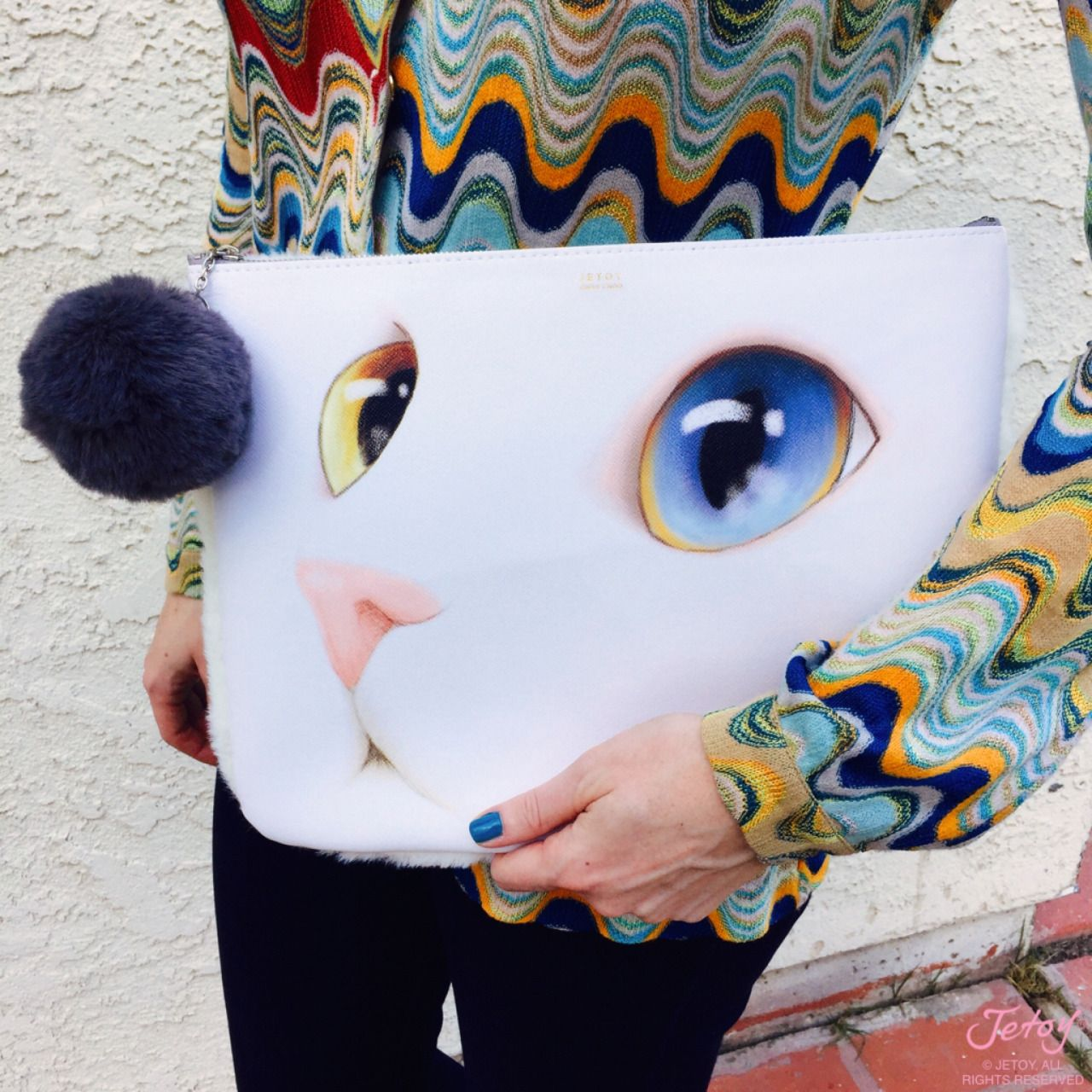 New furriends: our limited edition Cat Face Clutch has a faux fur back and pom pom! This Valentine's Day >