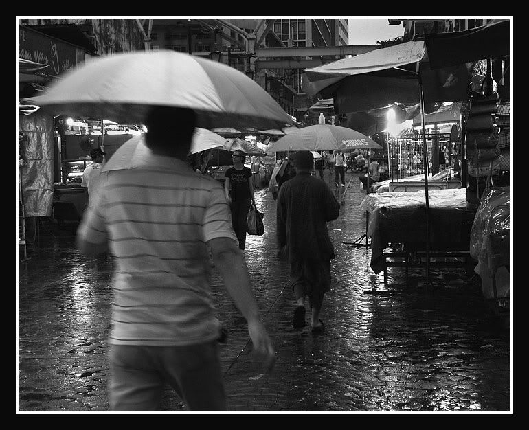 Walking in the rain in Petaling Street Chinatown.