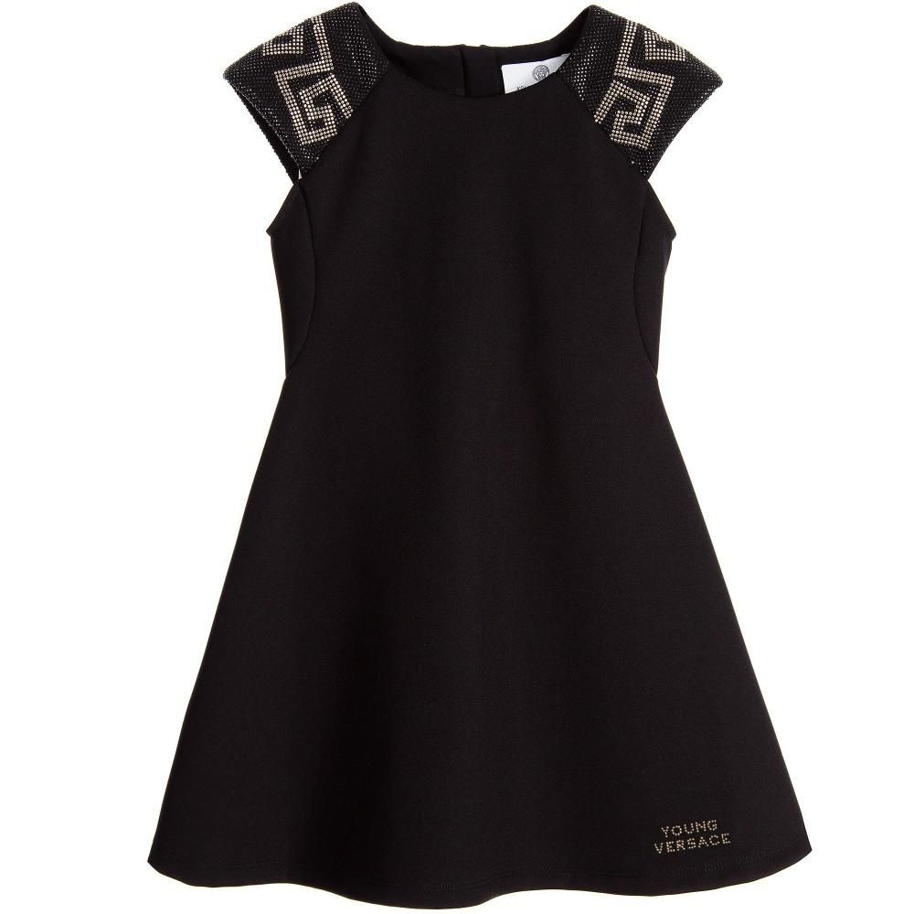 ce49965c Super chic, girls dress by Young Versace with a feminine shape thanks to  the cap-sleeves and flared skirt. Each shoulder is covered in silver and  black ...