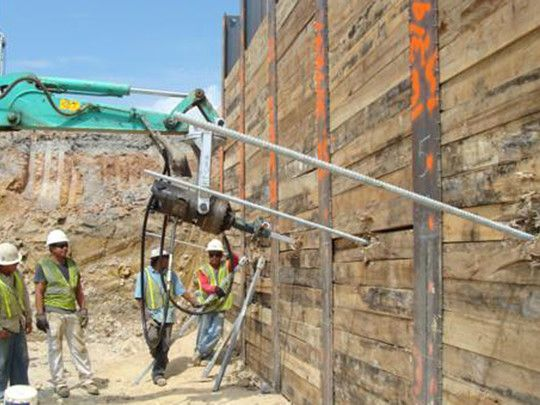 Drilling Helical Anchors into Retaining Wall | Helical Piers