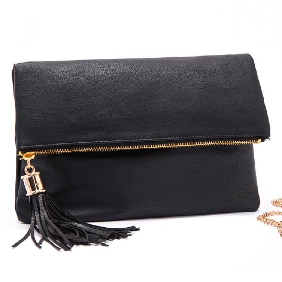 Black vegan leather clutch crossbody gold zipper Absolutely stunning bag perfect for dinner dates & shopping! Multiple pocket with gold zippers, tassel embellishment, and crafted from the highest quality vegan pebbled matte leather...Ships appx 2.5 weeks after purchasing. Promise it's worth the wait! Avail in black only. Goes with everything! Bags