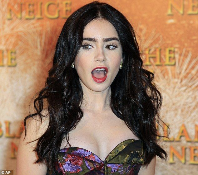 Collins is astoundingly beautiful in sumptuous forest green and floral gown as she takes her Snow White tale to Paris wow, lily collins, love those eyebrowswow, lily collins, love those eyebrows