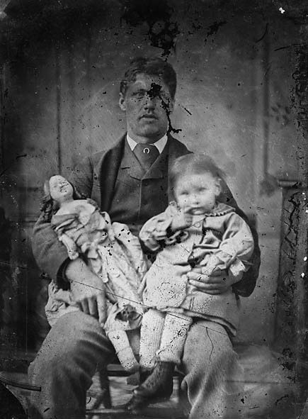 Man with his daughter and her doll