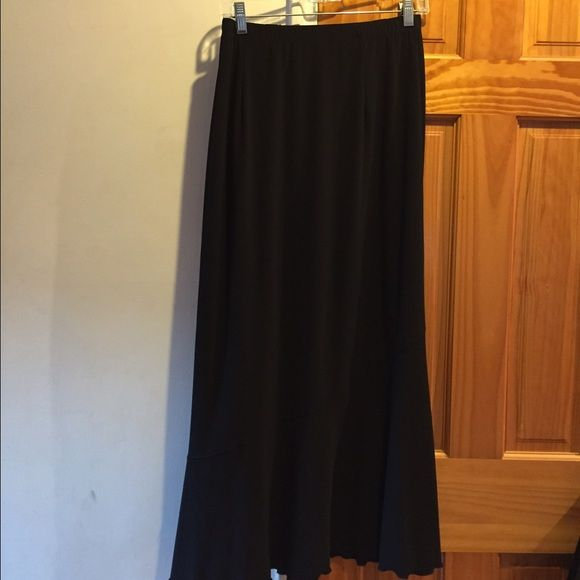 Black Maxi Skirt Black Maxi Skirt with asymmetrical line made by Clara S. Size is Medium and is in excellent condition. Clara S. Skirts Asymmetrical