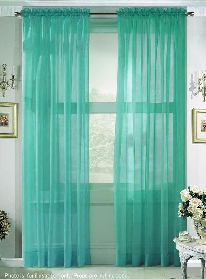 Sheer Turquoise Curtains Put Over Another Fabric W Pattern