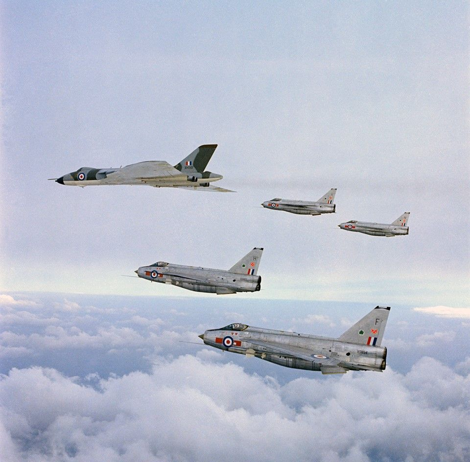 A Vulcan B 2 leading four English Electric Lightning F 6s in
