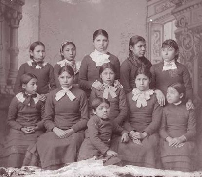 Carlisle Indian Industrial School portrait of female Omaha Indian students in school uniforms in 1894. (NAA INV 06821500. National Anthropological Archives, Smithsonian Institution)