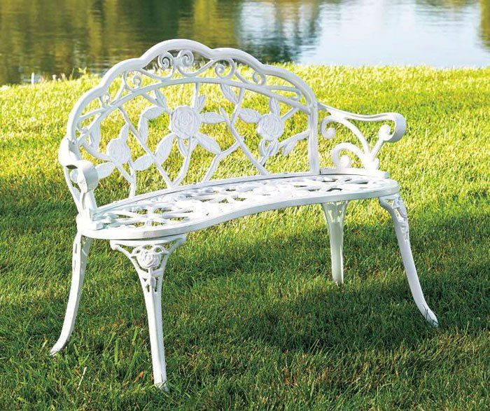 How To Decorate a Small Front Porch Cast iron bench