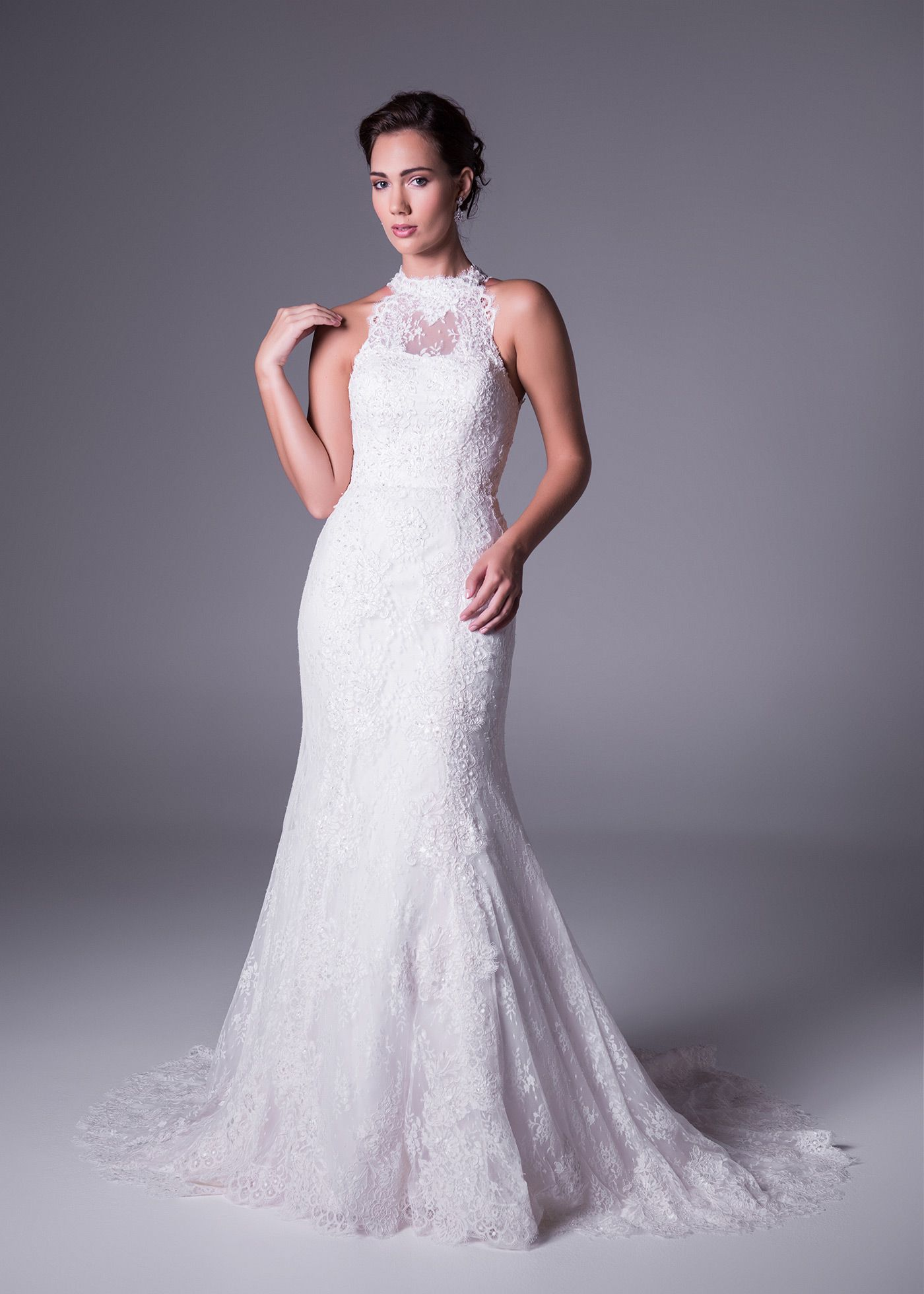 Trend: Turtle Necks  Following on the popular high-neckline trend, turtle neck wedding dress designs offer plenty of warmth for winter weddings and the ultimate in chic sophistication and something different for your wedding day look. We love this Oleg Cassini all-over-lace, fit and flare style wedding gown. Available in Whisper Pink and Ivory (style: CWG666). Click to View.
