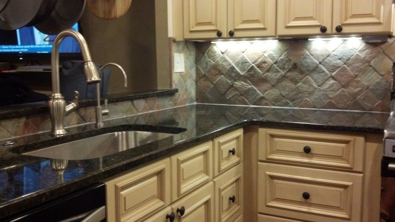 Stainless Steel Sink With Granite Countertop And Tuscany Maple Cabinets.  All Available On Our Website