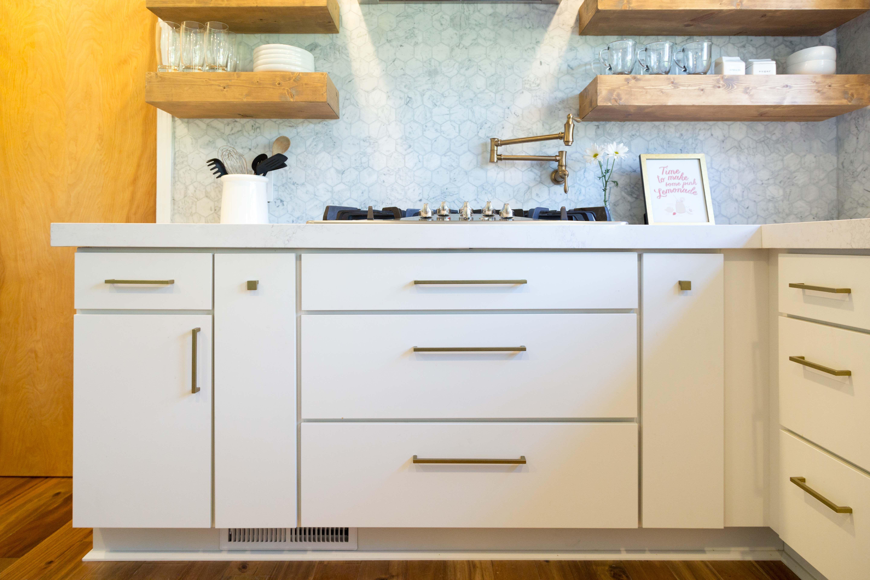 Modern Makeover Of A 1960s Kitchen Slab Door Cabinets Kitchen Cabinet Handles Kitchen Cabinet Door Handles