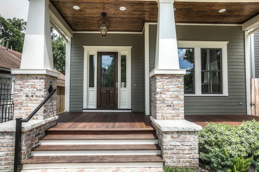 Large covered front porch with a stained bead board ...