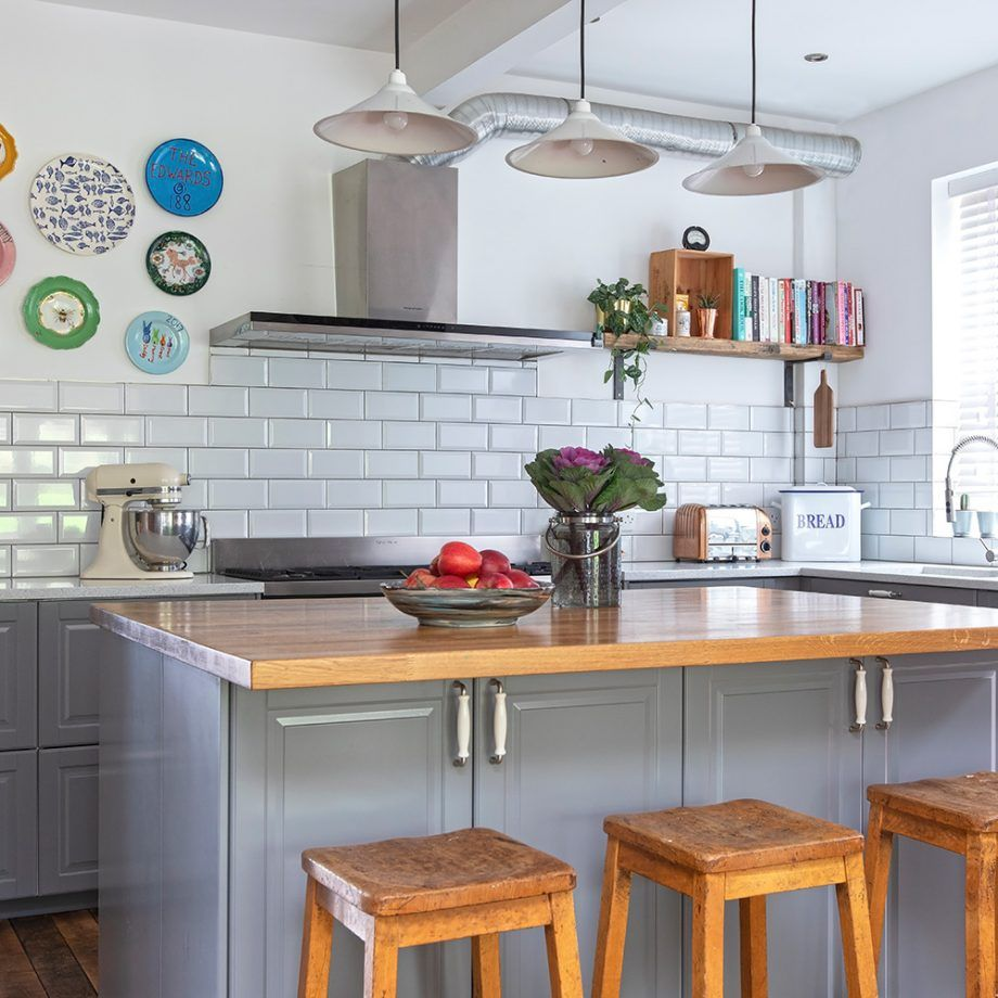 Grey kitchen makeover with white metro tiles, wood floors and ...
