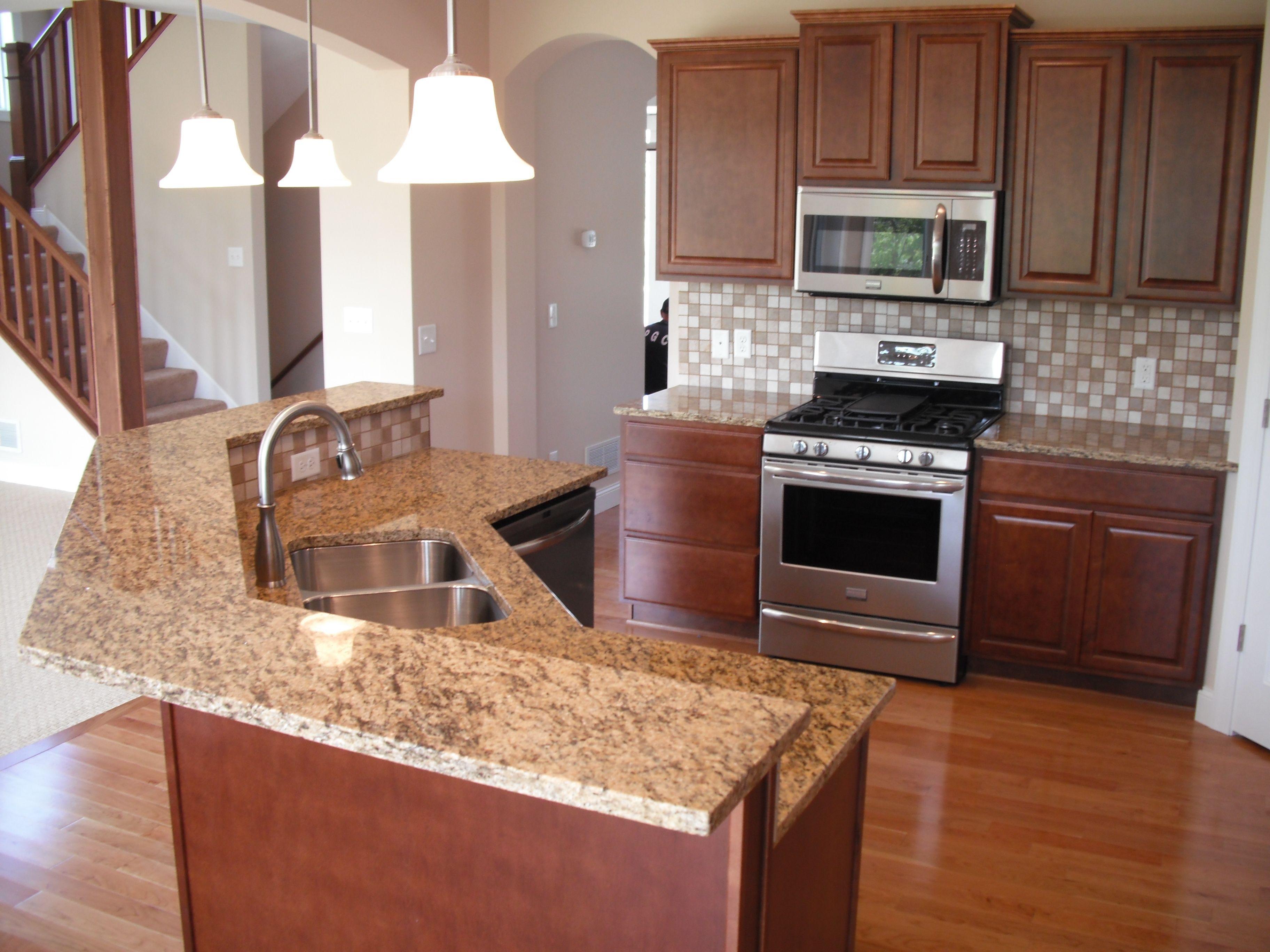 Two Tier Kitchen Island Ideas St Cecilia Dark 2 Tiered Granite Island Kitchen Island With Sink Curved Kitchen Kitchen Layout