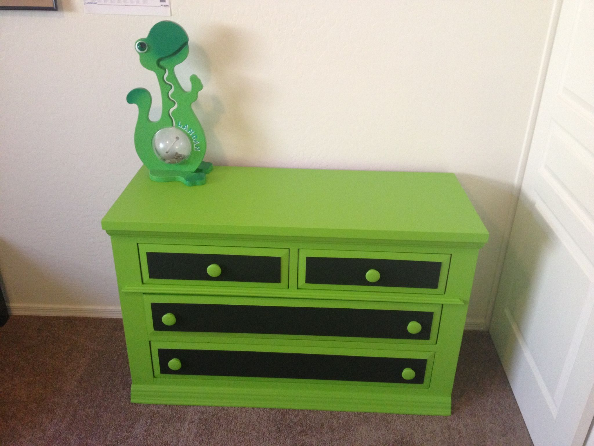 Kids dresser with chalk board paint on front of drawers.