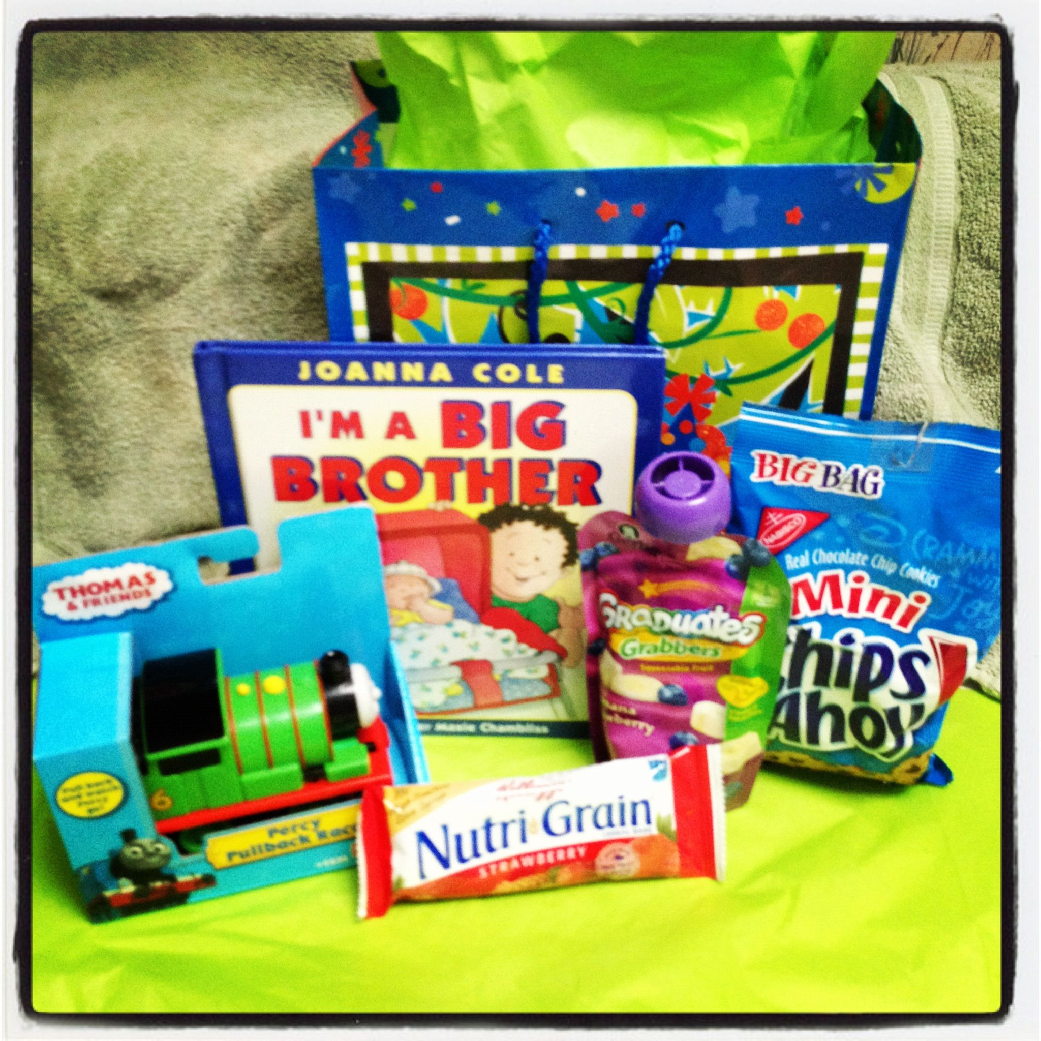 Big brother gift from baby:   -big brother book -Thomas train  -some of his favorite treats   Pick out a few of older child's favorite things and give as a gift from baby in the hospital. :)