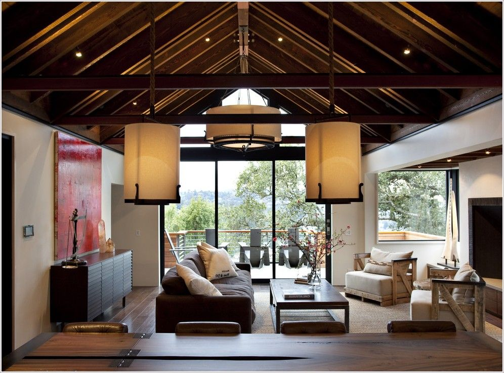 While High Ceilings Are Architecturally Appealing They Present Challenges For Installing Light Fixtures So Consider Th Home Rustic Living Room Hillside House