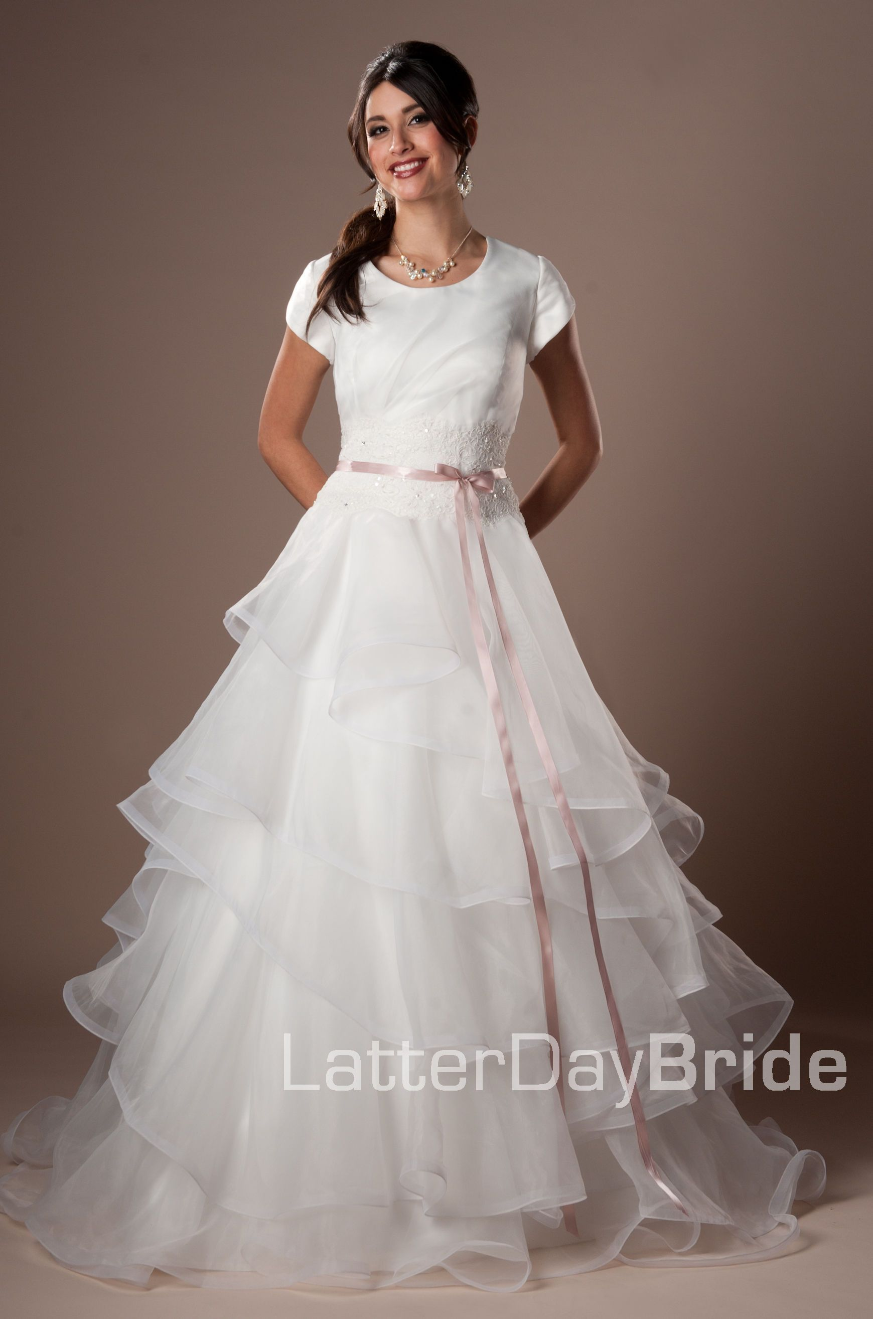 Briella style in ivory with my vera wang blush sash modest wedding